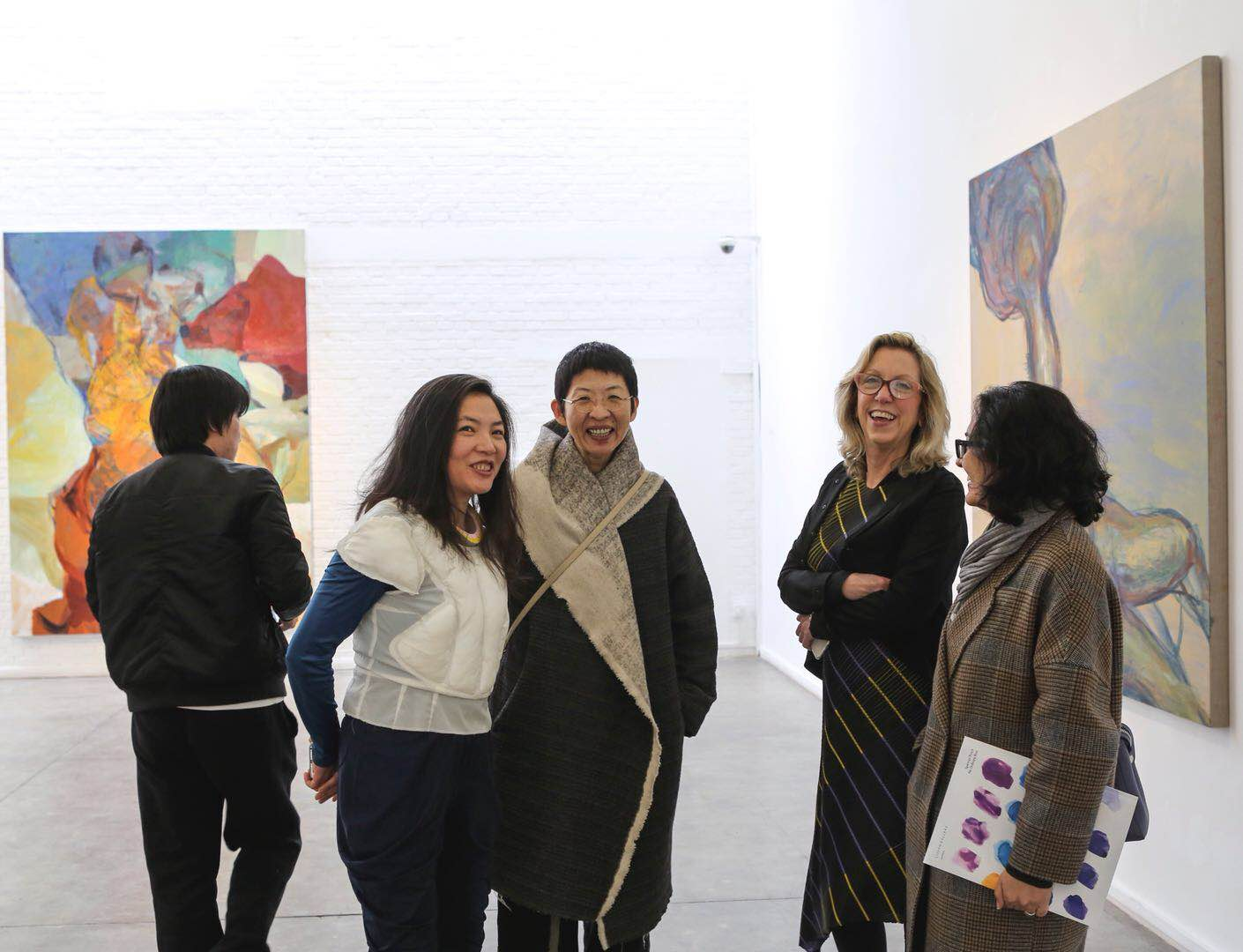 Ms. Meg Maggio (the second from the right) talked with visitors at Pékin Fine Arts.jpg